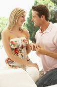 image of propose  - Kneeling Young Man Proposing To Woman - JPG