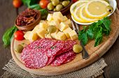 pic of antipasto  - Antipasto catering platter with salami and cheese on a wooden background - JPG