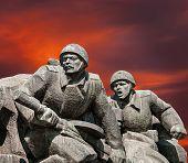image of ww2  - Soviet era WW2 memorial in Kiev Ukraine against red clouds - JPG