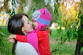 pic of knitted cap  - daughter in a knitted cap with his mother in the park - JPG