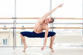 picture of ballet barre  - in the hall man doing stretching near Barre - JPG