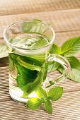 foto of mints  - Mint tea with fresh mint leaves on a wooden background - JPG
