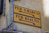 stock photo of old bridge  - Directional sign to San Marco square and Rialto bridge on old Venetian building - JPG