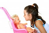 picture of baby doll  - beautiful little girl playing with her doll - JPG