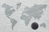 pic of hockey arena  - Hockey puck on the ice with the image of a world map - JPG