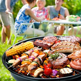 picture of eat grass  - Family having a barbecue party in their garden in summer - JPG