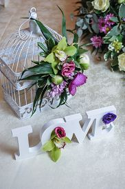 stock photo of wedding table decor  - Wedding decor, LOVE letters and flowers on table. Fresh flowers and LOVE decoration on festive table. Luxurious wedding decoration on restaurant table. Elegant event ** Note: Shallow depth of field - JPG