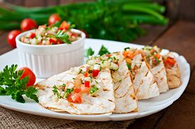 stock photo of sweet-corn  - Mexican Quesadilla wrap with chicken - JPG