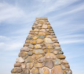 picture of triangular pyramids  - Pyramidal shaped stone monument and sky with copy space - JPG