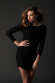 pic of tight dress  - Beautiful young brunette in a tight black dress - JPG