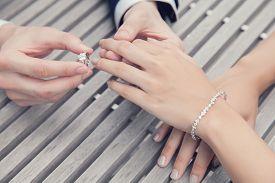 stock photo of wedding  - a photo of couple wedding engagement with diamond ring - JPG