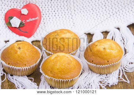 Appetizing tasty fruitcakes on a decorative napkin and heart with an inscription ' With love! '
