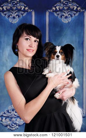 portrait of elegant lady with a dog