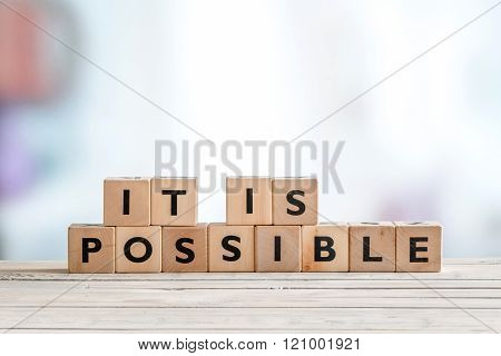 It Is Possible Sign Made Of Wooden Cubes