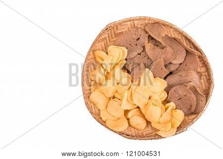 Dried Raw Prawn And Fish Crackers On Traditional Rattan Tray