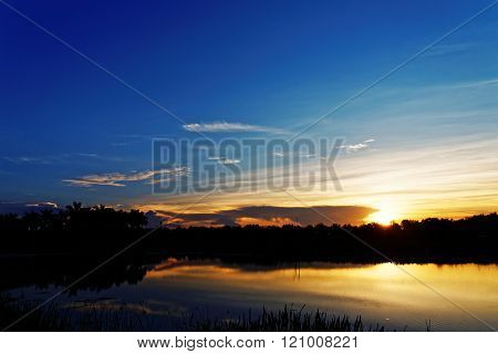 Vibrant Orange Sunrise Over Water