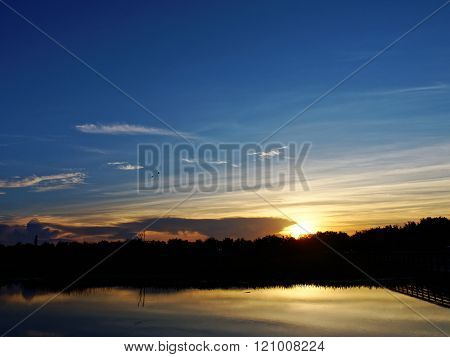 Sun Rising Over Water at Green Cay Wetlands in Florida