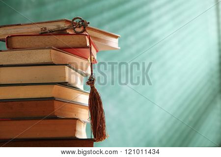 key on stack of books in front of blackboard