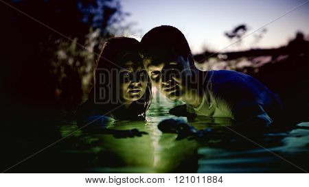 Young Couple In The Magic Luminous River