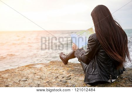 Woman on the pier watching map