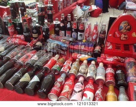 A collection of vintage coca cola bottles