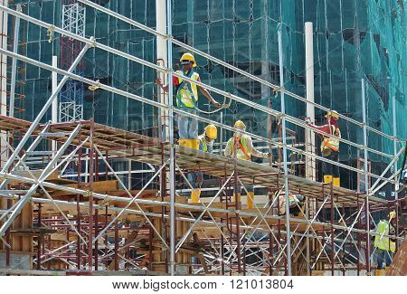 SELANGOR, MALAYSIA - FEBRUARY 11, 2015: Scaffolding used to support a platform or form work as the temporary structure at the construction site for construction workers to work.