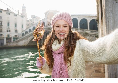 Happy Woman With Venice Mask Near Rialto Bridge Taking Selfie