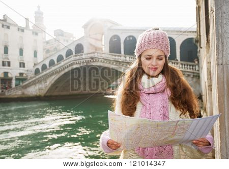 Happy Woman Tourist Looking On Map In The Front Of Rialto Bridge