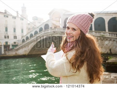 Happy Young Woman Tourist With Map Pointing On Rialto Bridge