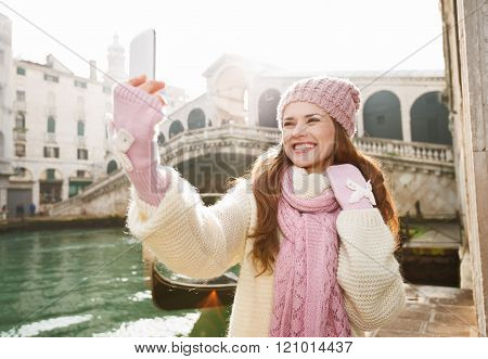 Happy Woman Tourist Taking Selfie In Front Of Rialto Bridge
