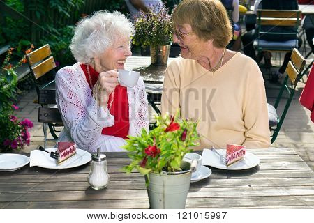 Two Senior Ladies Enjoying Outdoor Refreshments.