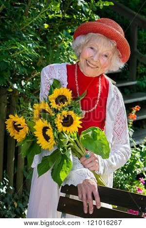 Chic Senior Lady In A Colorful Red Summer Ensemble.