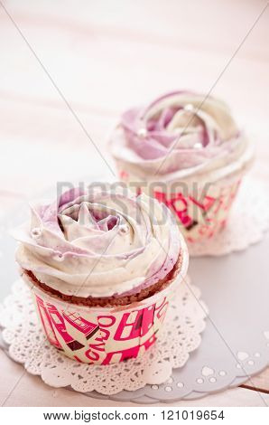 home made cupcakes chiffons with creme rose ** Note: Shallow depth of field