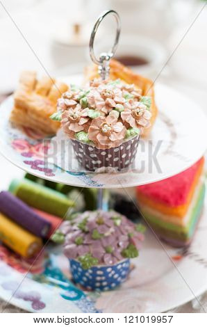 delicious desserts arranged and served on a cake stand in an english high tea style