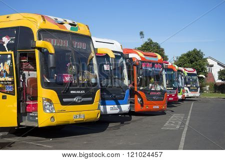 Colorful long-distance buses are at the bus station of da lat before departure. Vietnam
