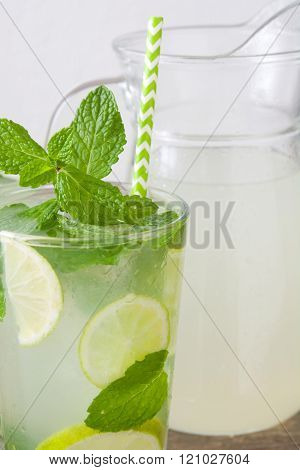 Summer drink. Fresh mojito on a rustic wood