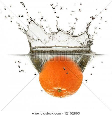 Close-up image of an orange plunging into water