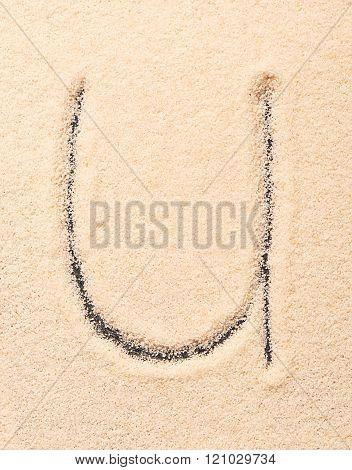 U Letter Written On Sand