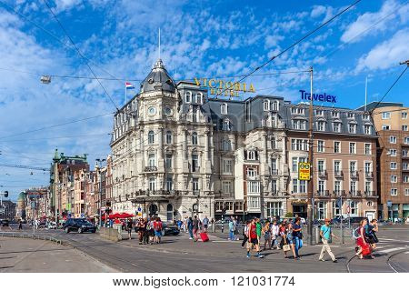 AMSTERDAM, NETHERLANDS - JULY 07, 2015: People in the center of Amsterdam - capital city and most populous in Netherlands, popular tourist destination with more than 5 million visitors annually.