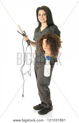 A teen cosmetology student carrying the equipment she needs to practice hair styling on her mannequin head.  On a white background.