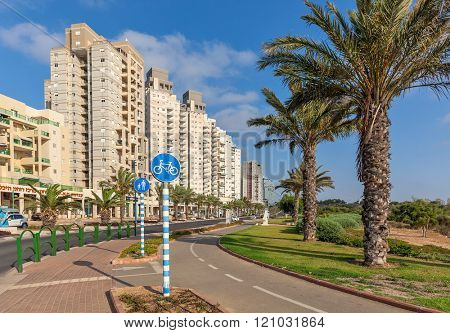 ASHQELON, ISRAEL - JULY 25, 2015: Contemporary residential buildings on avenue in Ashqelon - popular tourist resort and coastal city in Southern District of Israel on Mediterranean coast.