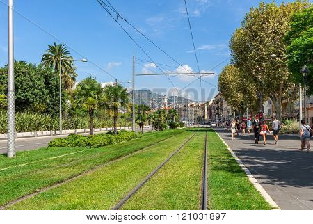 NICE, FRANCE - SEPTEMBER 02, 2015: Tram rails on green grass in the center of Nice - second-largest  on Mediterranean coast, fifth most populous city and popular tourist resort on French Riviera.