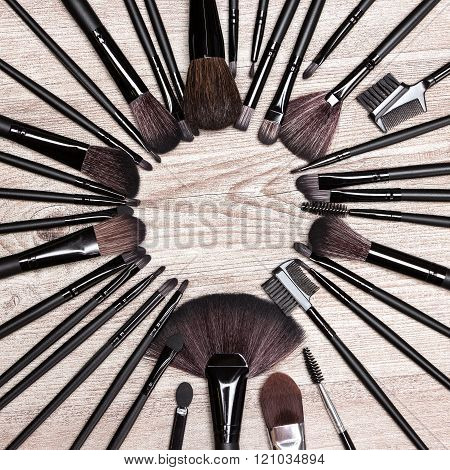 Various Makeup Brushes Laid Out As Round Frame