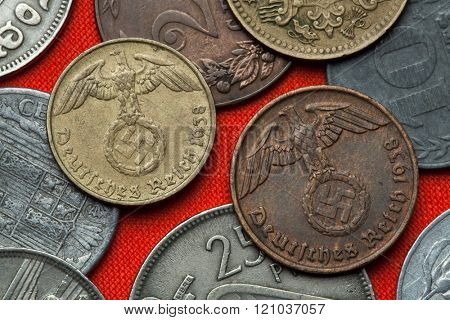 Coins of Nazi Germany. Nazi eagle atop swastika depicted in the German Reichsmark coins (1938).