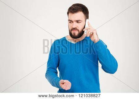 Angry man talking on the phone isolated on a white background
