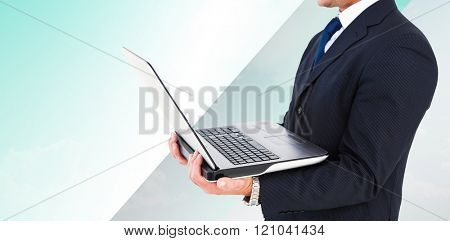 Businessman with watch using tablet pc against blue sky over green field