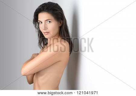 Middle Aged Grinning Woman Covering Her Chest