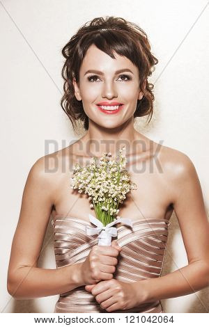 Portrait Of Young Gorgeous Bride With Wedding Bouquet