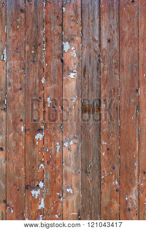 Wall Of The Old Boards With Traces Of Peeling Paint