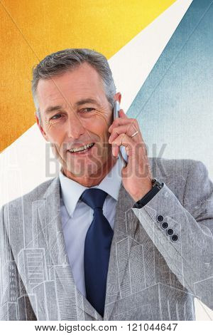 Portrait of buisnessman taking on mobile phone against hand drawn city plan